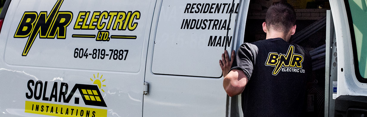 BNR Electric employee going into electrician's van